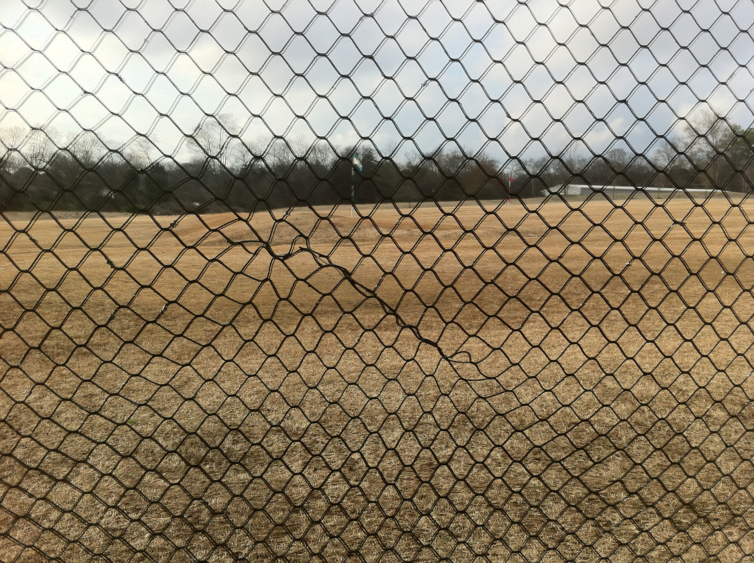 Hole Repaired in the Driving Range Net